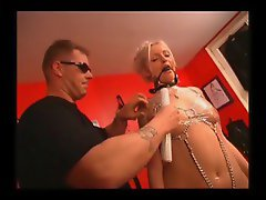 Girl ball gagged and wrapped in plastic
