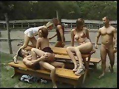 Hot group sex scene on a farm