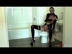 Rubber girl using the shower head on her pussy
