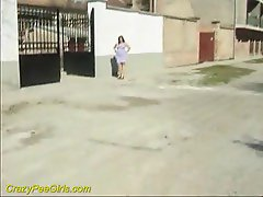 Sexy chick peeing on the side of the road