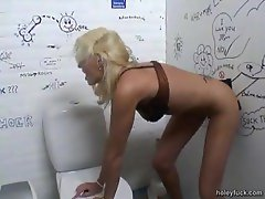 Hot blonde nailed at the bathroom gloryhole