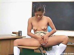 Schoolgirl masturabates in the classroom