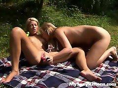 Teen lesbians toying outdoors