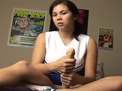 Cheerleader strokes a huge dildo