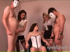 Hot minx in sexy corset giving two guys handjobs