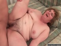 Floppy granny with rolls getting pounded by young guy
