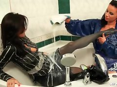 Girls in satin make a mess in the bathtub