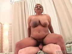 Gross granny enjoying a younger mans fat cock