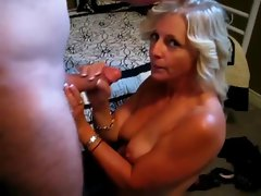 Golden haired mature sucks and strokes dick