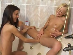 Skinny oiled up teen fisted in bathtub