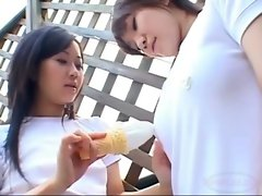 2 Asian Teens Licking Icecream From Each Other Body Outside On The Balcony