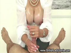Busty slut oils up cock