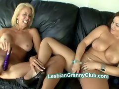 Blond granny Erica pleases young chubby beauty with big natural boobs