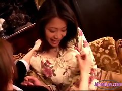 2 Asian Girls Kissing Sucking Nipples Patting While Sitting On The Armchair In The Sitting Room