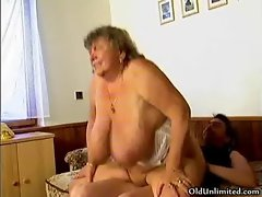 Dirty grandma with big tits riding