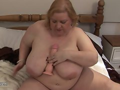 Big filthy mom playing with her enormous boobs and older pussy