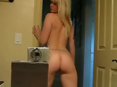 tattoo light-haired teenager striptease