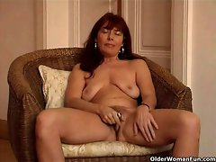 Saggy granny Sara works her hirsute muff with a vibrating sex toy