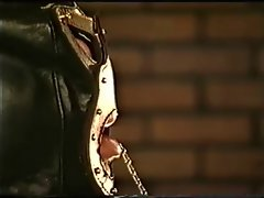 Leather Gloved Dark haired Dominatrix Smoking Torture Up-Close