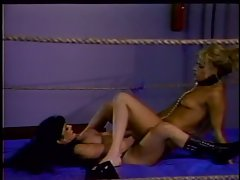 Butch nymphos wrestle and fuck strap on