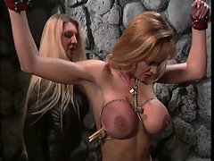 Big titted madam in BDSM activity with a sensual big melons tempting blonde