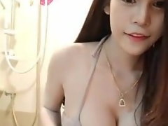 sensual chinise in swimsuit doing selfies.mp4