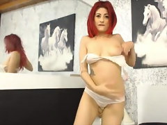 Charming red-haired girl masturbates