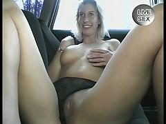 Amateur blonde masturbates in car