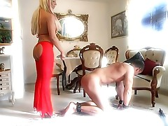 Blonde MILF slaps her slaves ass with whip