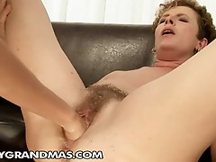 Lesbian Granny's hairy pussy gets fisted