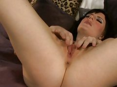 Sexy slut finger fucks her dripping slot on the bed