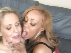 A shared cumload for Julia Ann and her hot mate