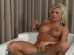 Hot horny blonde with huge tits plays in the bath