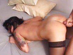 Tattooed Katrina Kravin gets her ass sprayed with cum