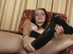 Red hot slut stretches her snatch with a huge dildo