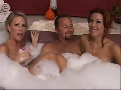 Two milfs in the hot tub with lucky guy