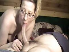 Cute wife in glasses deepthroating dick