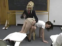 Teacher spanks girl in the classroom