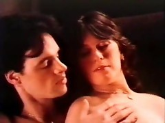 Retro porn movie includes a group scene