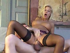 Hot young blonde in stockings fucked