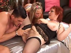 Mature redhead joined by young couple