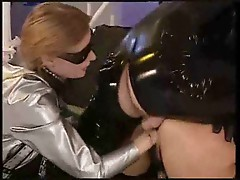 Latex fetish group scene with fisting