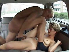 Chick in glasses plugged in the car