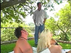 See a bimbo take two dicks outdoors