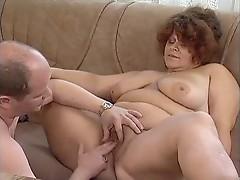 Chubby dude fucks a fat redheaded slut
