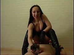 Dominatrix masturbates his cock in boots