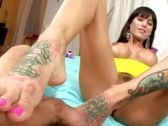 Haley Wilde rubbing the cock by her feet