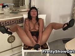 Busty slut working on a huge dildo