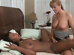 Ebony and ivory lesbians fucking on bed