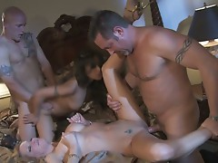 Muscular studs pound their women in hot foursome